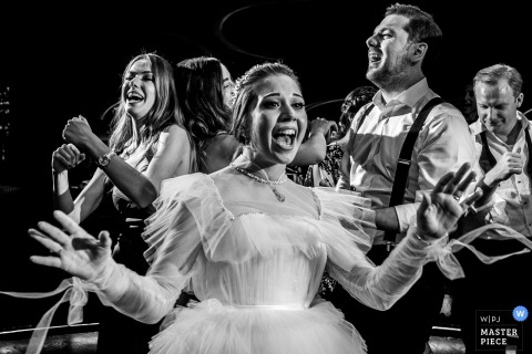 Wedding Venue Photography from JW Marriott Ankara - Bride is dancing with her friends on the dance floor