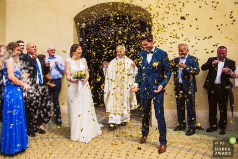 Church in Lenti, Hungary - after the ceremony photography | Confetti for the groom and rice for the bride