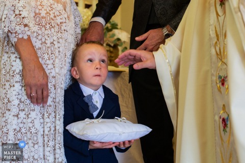 Pordenone Wedding Photos with Small Boy During The blessing of the rings