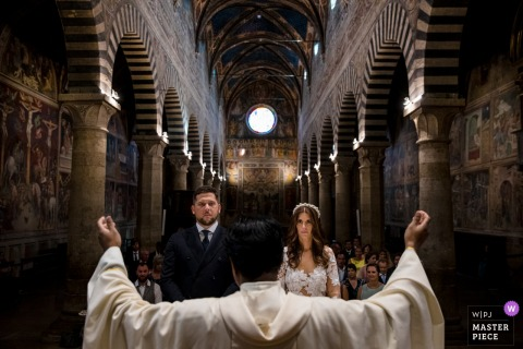 San Gimignano, Tuscany wedding ceremony photography of the priest, couple, church, blessing