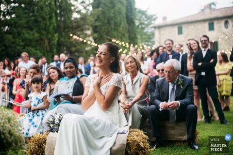 Casale Bellavista Wedding Photos Outside - Bride emotion during her newly husband speech