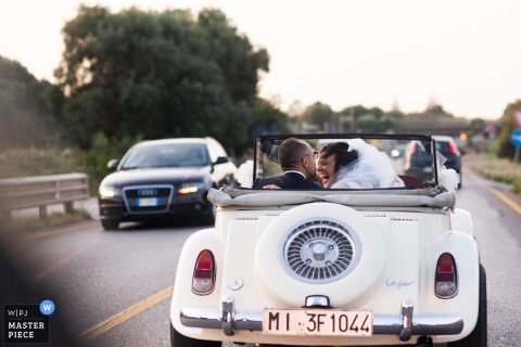 Locorotondo convertible car ride for the bride and groom - Wedding photos showing driving through apulia region