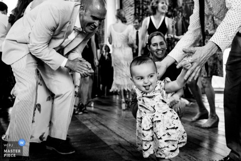 Felicity Church New Orleans Wedding Photographer - Dance floor action with baby