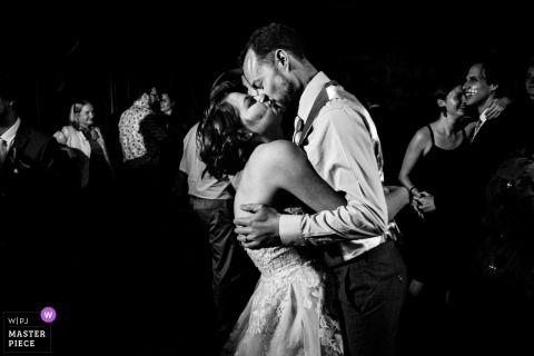 Colehayes Park Devon Wedding Photographer - Image of the Bride and Groom kiss on the dancefloor