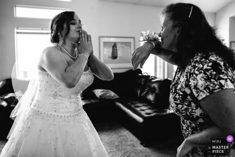 South Lake Tahoe Wedding Photography from a Private Home - A bride and her mother goof off before the ceremony.