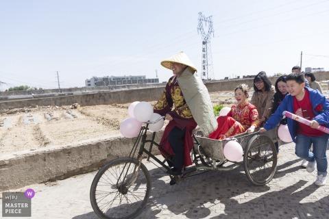 Photographie de mariage Shaanxi - Voiture / vélo de mariage avec la mariée