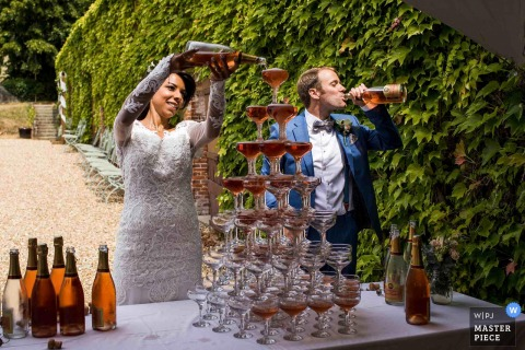 Wedding Venue Photography: Chateau de Miserai, Normandy, France	Champagne Tower, First Drinks!