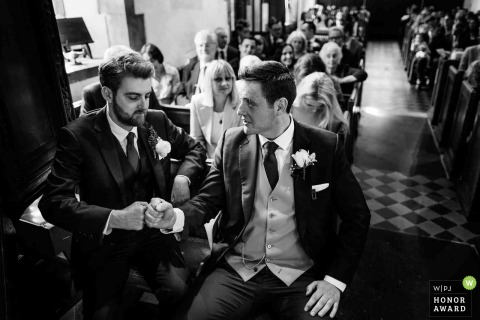 London, United Kingdom black and white wedding reportage | Groomsmen Fist Pump before the start of the ceremony