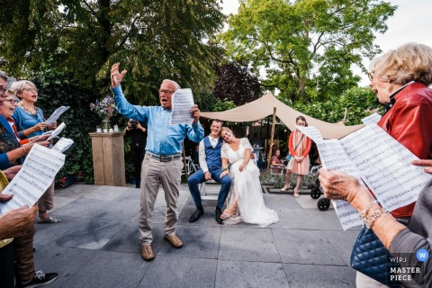 Netherlands wedding photographer — In the garden from from this couple!	The bride is leading her won choir, and these group was singing a song for them!