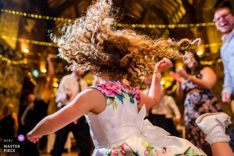Hatfield House, Hertfordshire	wedding reception photography - young guest with serious dance moves