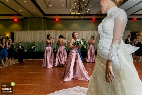 Newnan Centre wedding venue photo | Bridesmaid catches bouquet, bride reacts