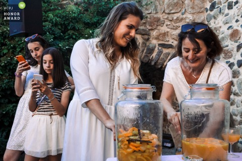 la Ferme de Lavée wedding venue photo of the reception drinks and teens on phones