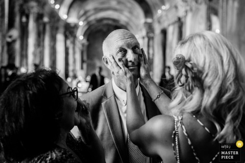 Mairie Capitole, Toulouse wedding photography of the groom's father being moved after the ceremony
