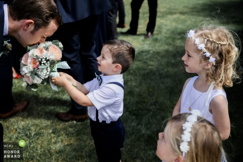 Paris - FranceWedding Photo with Kids | The Groom smells the bouquet
