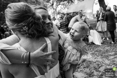 North Star Farm & Event Center wedding venue photo | Kids and Hugs after ceremony