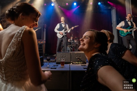 Minnesota wedding venue photography | Varsity Theater Bride watching Groom on stage with guitar and the band