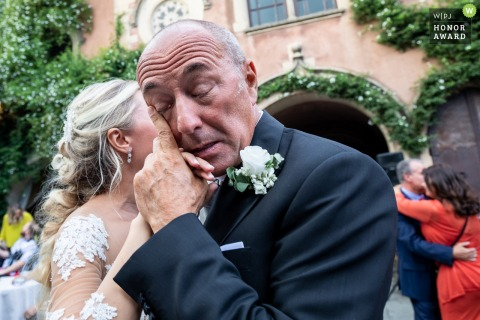 Castello Xirumi Serravalle - Lentini wedding venue photo | Papa wipes his tears outside while dancing with the bride.
