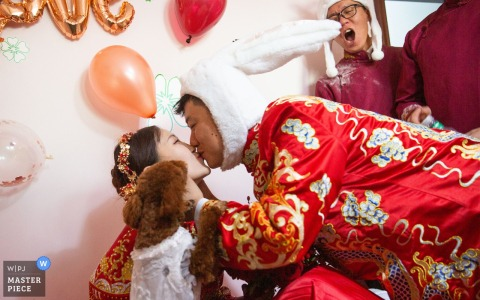 Xining, Qinghai wedding photography - When the bridegroom kisses the bride, the bride's favorite puppy has also joined.
