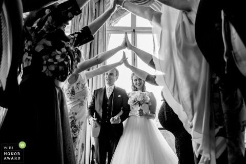 Amsterdam - Intercontinental hotel wedding venue photo | Living arch for the bride and groom to walk under | Arms and hands in black and white