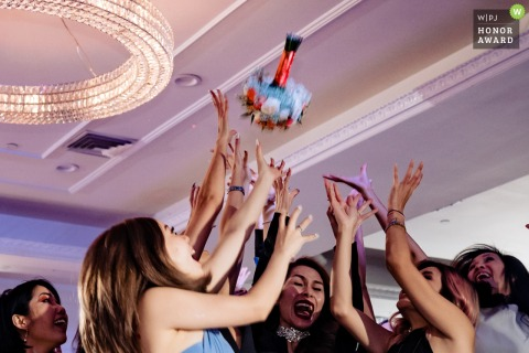 Orange County California Wedding Reception Venue Photo | Bouquet toss into many hands of waiting women