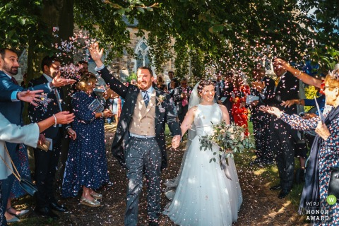 Louth church ceremony photography | Confetti throw as the bride and groom exited the church grounds