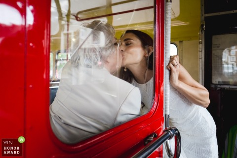Islington Town Hall, London wedding reportage photographer: Bride kissing grandma