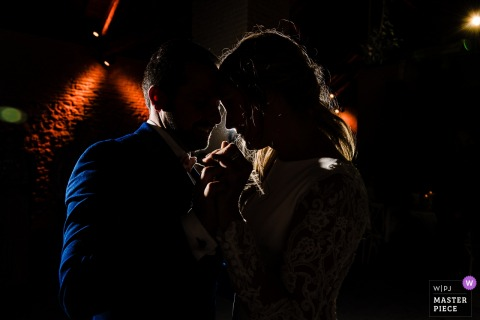 Wallonie wedding photographer — First dance on dark reception dance floor