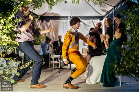 Orbey, France	reception party photo | The Groom surprises his bride with a Superhero costume and sensual dance