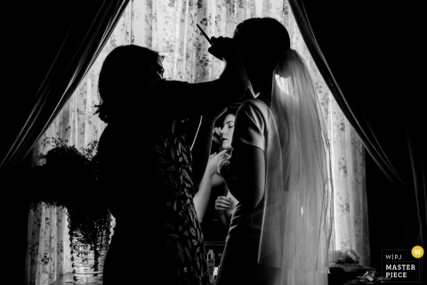 Casa Lavanda wedding photo in black and white of the brie receiving last minutes makeup touch-ups