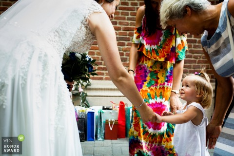 Wedding photo from the Church of Creative Communities, Lodz, Poland | The little girl wishes the bride and groom after the ceremony.