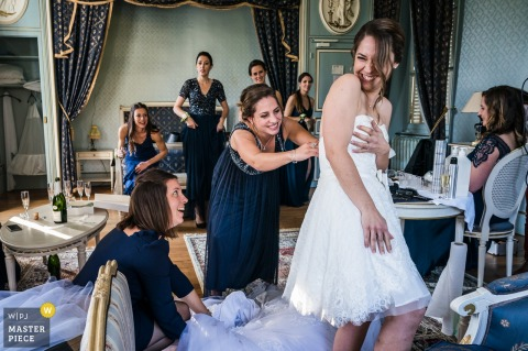 France wedding photography of Getting ready - Laughing suiting up