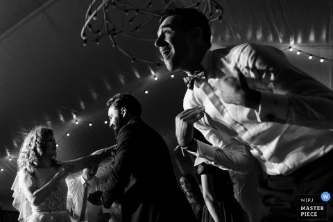 Lagoo Snagov	wedding venue — Photography: Bride, groom and the godfather dance during the reception party
