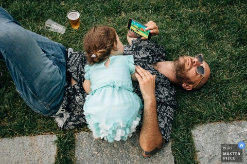 Piedmont	Cuneo Wedding Photographer - Image of Father and daughter relaxing on the grass