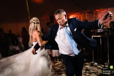 Antwerpen Wedding Reception Photographer: The father of the bride swings with his daughter, the bride