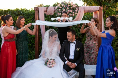 outdoor ceremony, turkey wedding photographer — A ritual at Iranian wedding ceremony