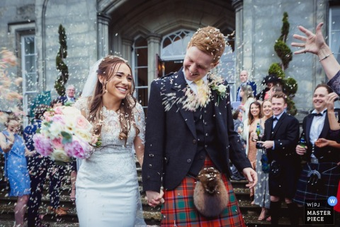 "Scotland Reception Venue Wedding Photography | Bride & Groom ""confetti tunnel"""