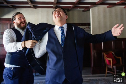 PA wedding venue photography | Groom has trouble putting on suit jacket for Hotel Du Village, New Hope, Pennsylvania wedding