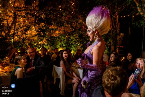 "wedding venue photography from Michael's Restaurant, Santa Monica CA	| drag queen Leilani Lopez entertains everyone during dinner with a lip sync of ""Poor Unfortunate Souls"" by Ursula"