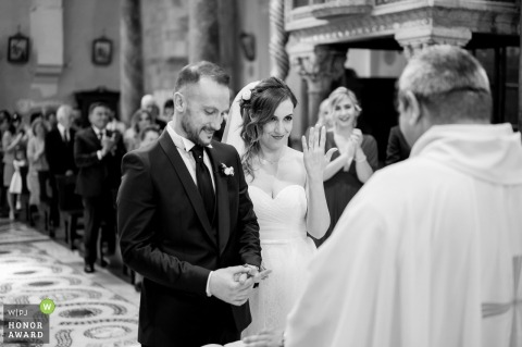 Terracina - San Cesareo Cathedral wedding photo from inside the church: The bride shows the ring to the priest