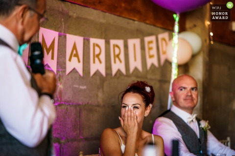 The Barns at Lodge Farm wedding venue photo: An emotional bride reacting to her dad's speech.