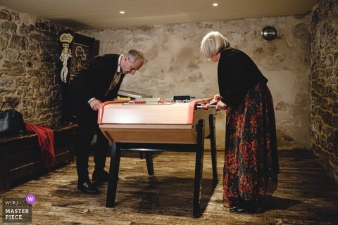 Brittany wedding photography | Waiting for the ceremony while playing foosball