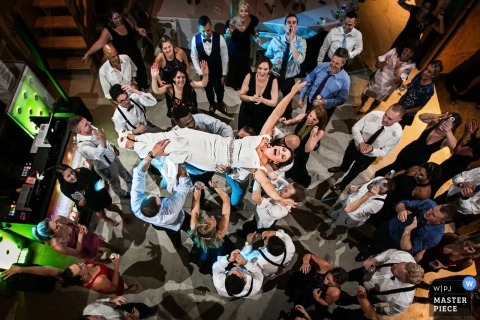 Reception photography in New Jersey | Bride is lifted into the air during the wedding reception