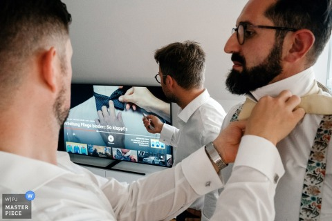 GermanyGetting Ready at home photography of the groom on wedding day - tie problems and video help