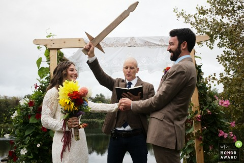 Private Home Connecticut Wedding Photo from the Backyard: Ceremony blessing by a wooden sword