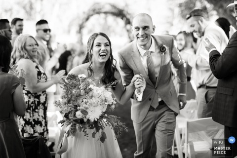 Backyard wedding photography, Longmont, Colorado| Bride and groom's departure from the ceremony.
