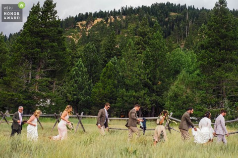 Squaw Valley Sierra High Camp wedding ceremony photo at the venue: Bridal party exit meadow as it starts to rain