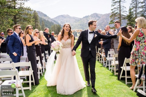 Resort at Squaw Valley outdoor wedding venue image: Bride and groom exit their ceremony