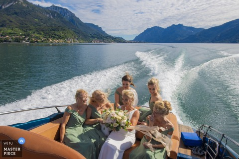 Bride on fast boat on Lake Como during the wedding day - Italy wedding photography