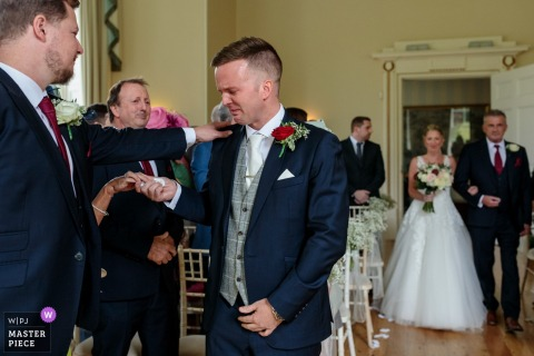 Charlton Park, Bishopsbourne, Kent, UK Wedding Venue Photos | The groom is overcome with emotion as his bride arrives with her father