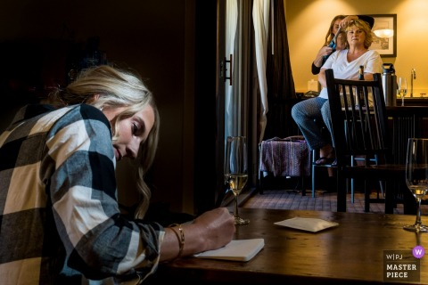 Coloradowedding photographer for Telluride Peaks Resort- The Bride finishing vows while mom gets hair done.